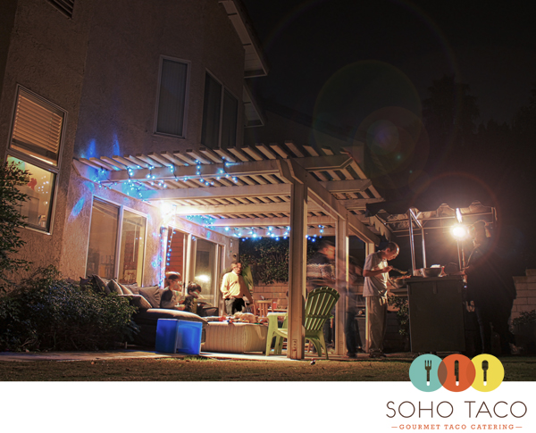 SoHo Taco providing gourmet taco cart catering (on the right) for an intimate backyard holiday party last weekend in the City of Irvine.