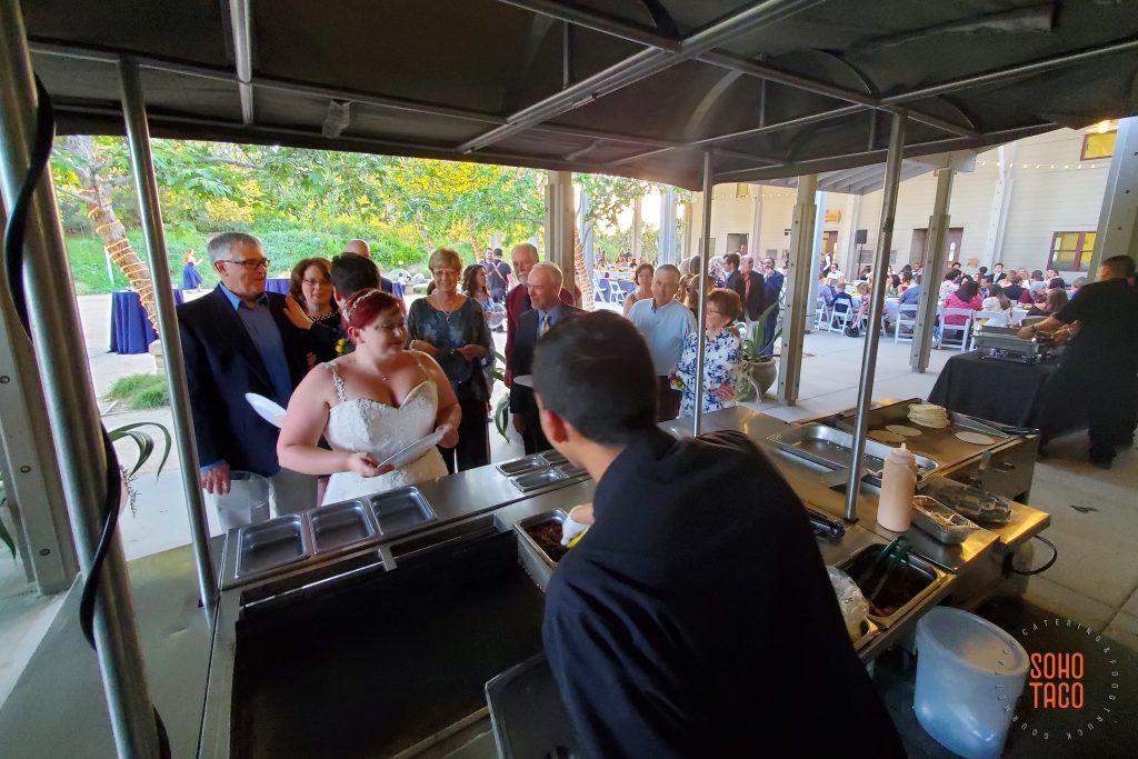 SOHO TACO Gourmet Taco Catering - Fullerton Arboretum Wedding - Bride at the Taco Cart