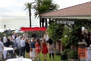 SOHO TACO Gourmet Taco Catering - Del Mar Surf Station - Wedding Engagement Party - Guests Enjoying themselves in front of the taco cart